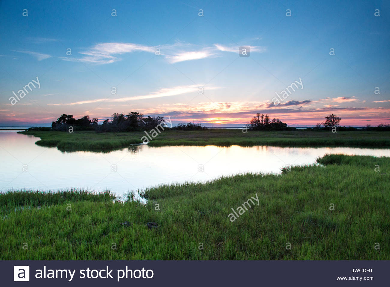 Evening colors fade over a marsh. - Stock Image