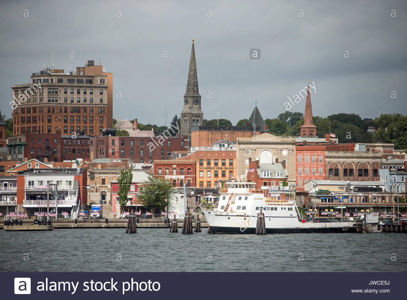 A scenic view of the waterfront in New London,Connecticut,under a cloudy gray sky. - Stock Image