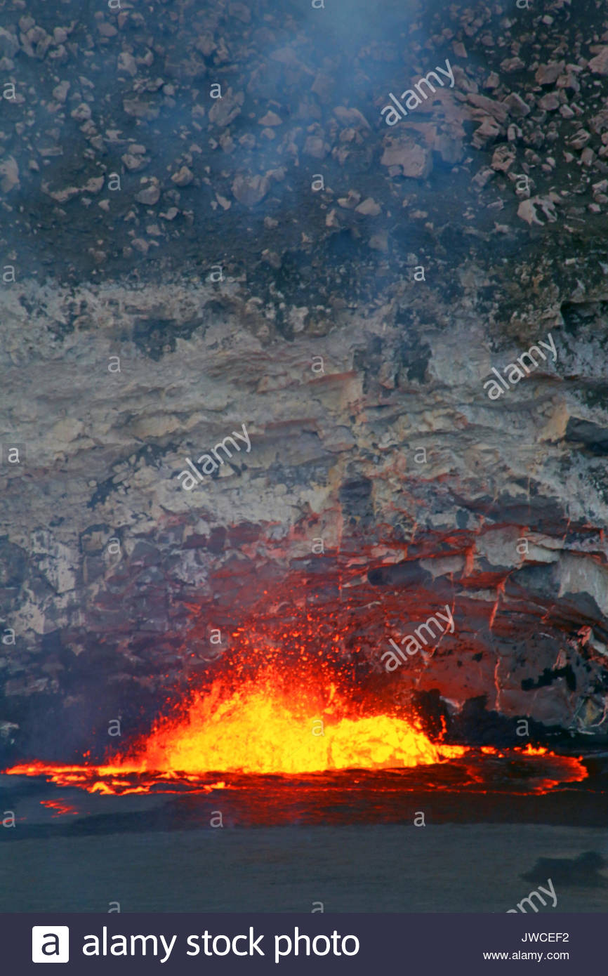 Lava fountains form in a lava lake at the summit of Kilauea volcano after lava spills over onto the floor of Halemaumau Crater. - Stock Image