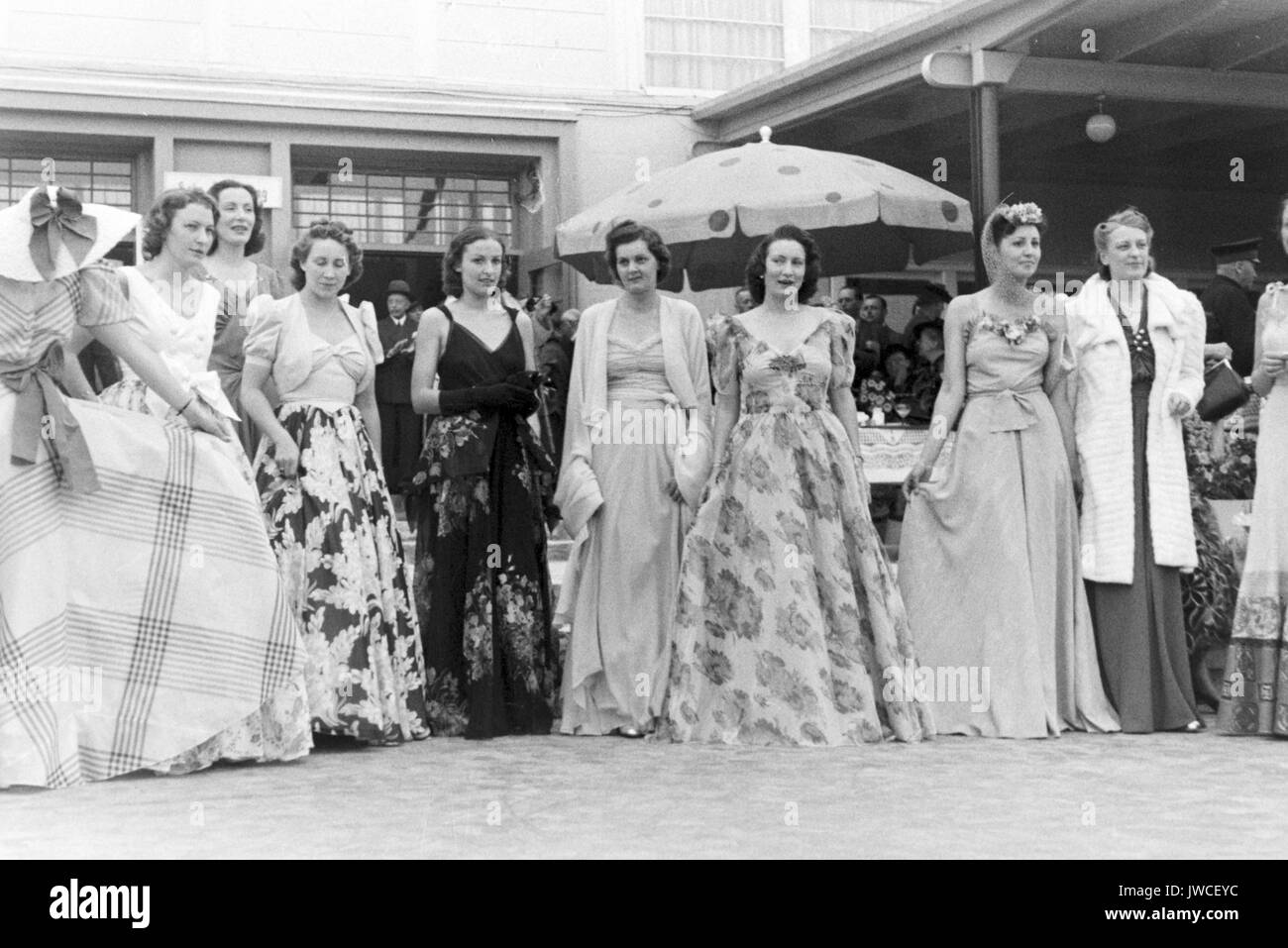Models in elegant evening dresses at fashion show. - Stock Image