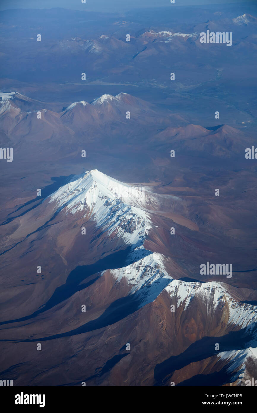 Cabaray (stratovolcano, 5869m/19,255ft), Andes Mountain Range, Bolivia, (and Chile in distance), South America - aerial - Stock Image