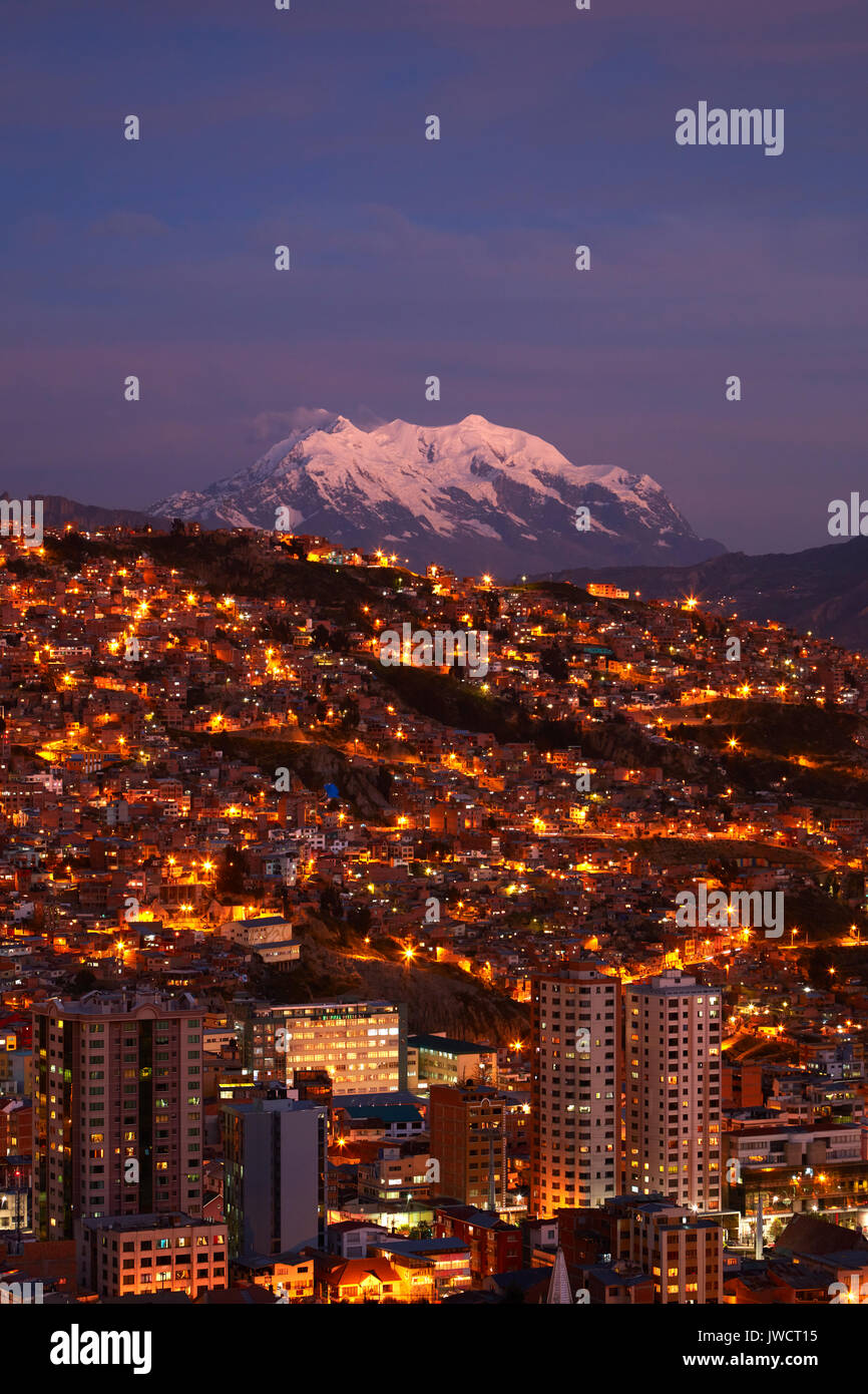 Last light on Illimani (6438m/21,122ft), and lights of La Paz, Bolivia, South America Stock Photo
