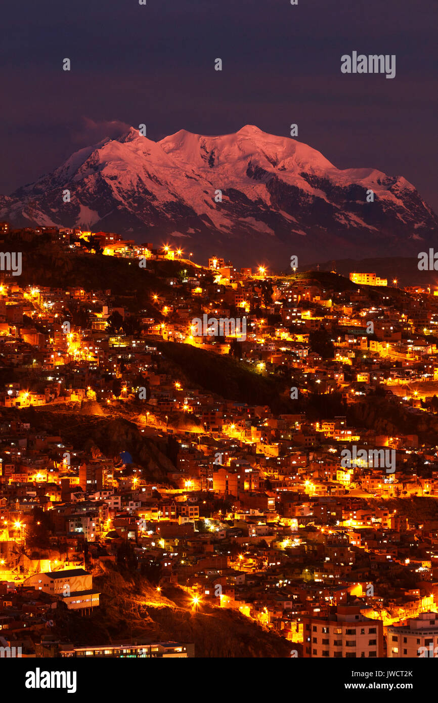Last light on Illimani (6438m/21,122ft), and lights of La Paz, Bolivia, South America - Stock Image