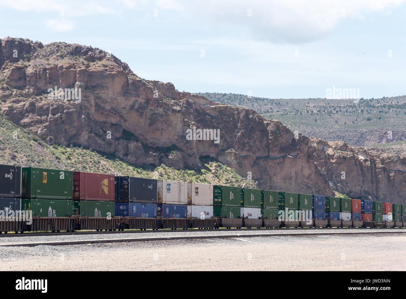 Double stacked intermodal containers on a freight train in Caliente, NV. - Stock Image