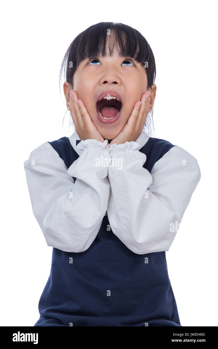 Asian Little Chinese Girl screaming with hands on her face in isolated White Background - Stock Image