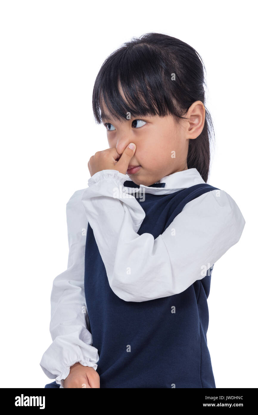 Asian Little Chinese Girl holding her nose because of a bad smell in isolated White Background - Stock Image