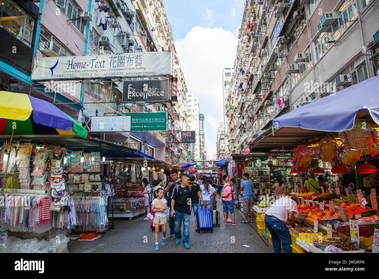 HONG KONG - JULY 10, 2017: Fa Yuen Street in Mong Kok is a popular street market where visitors go to shop for cheap fashionable clothing, homewares,  - Stock Image