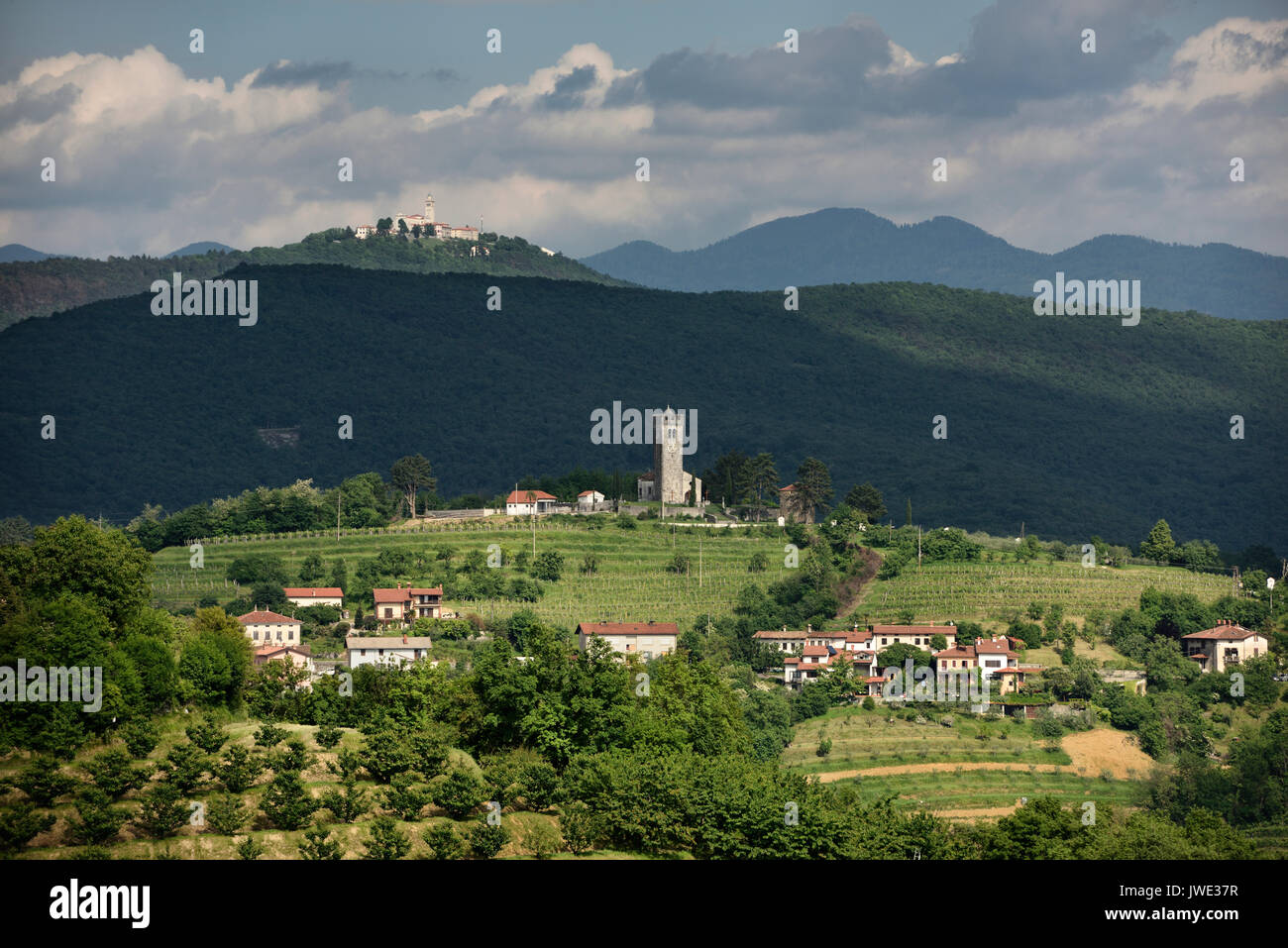 View of Church of the Holy Cross and Sveta Goro Holy Mountain with Basilica of the Assumption of Mary from Smartno Brda Slovenia - Stock Image