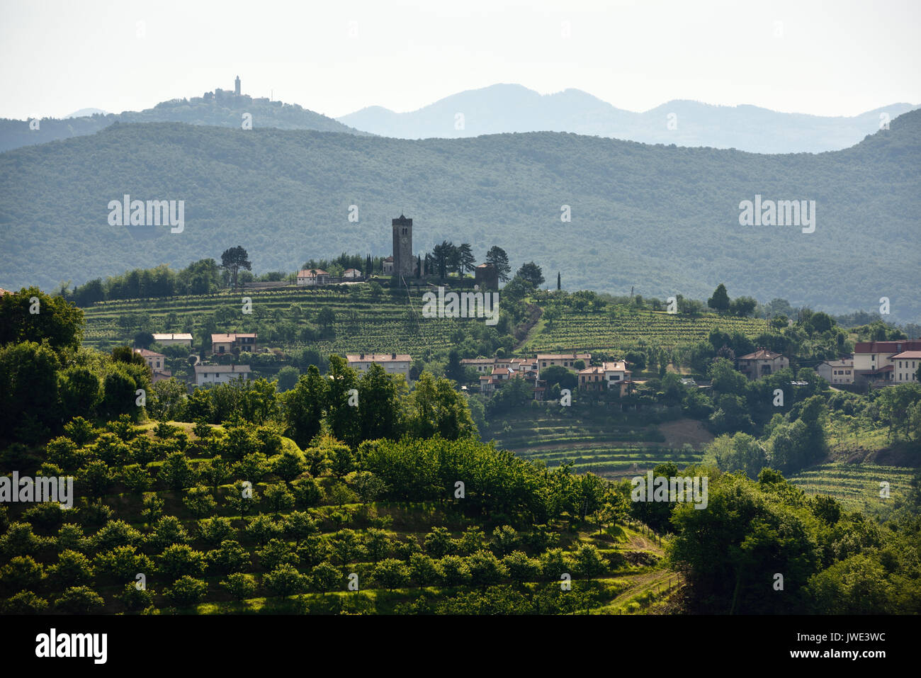 Church of the Holy Cross in Kojsko with vineyards and cherry orchards and Sveta Goro Holy Mountain with Basilica of the Assumption of Mary Slovenia - Stock Image