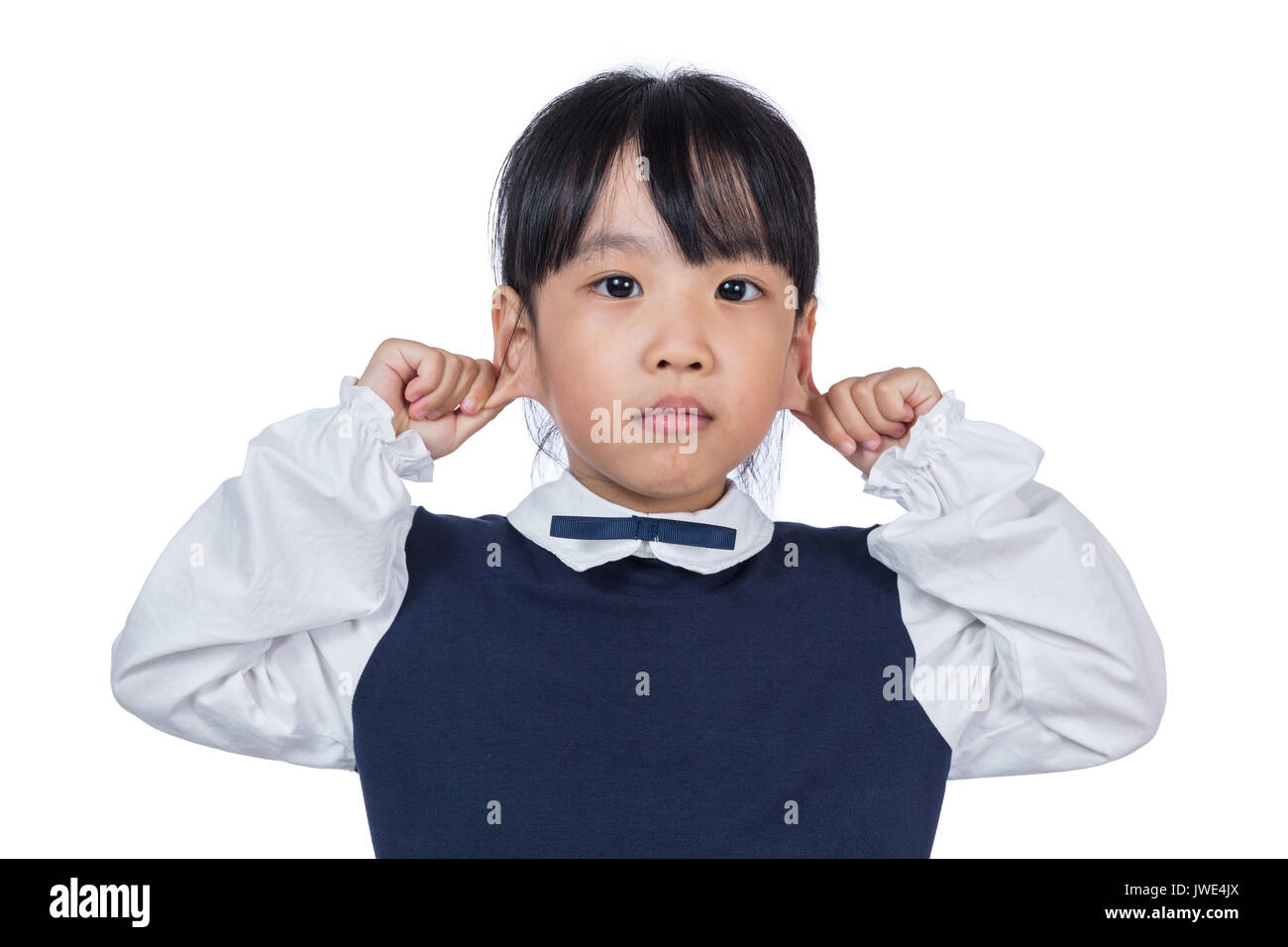 Asian Little Chinese Girl pulling her ears in isolated White Background - Stock Image