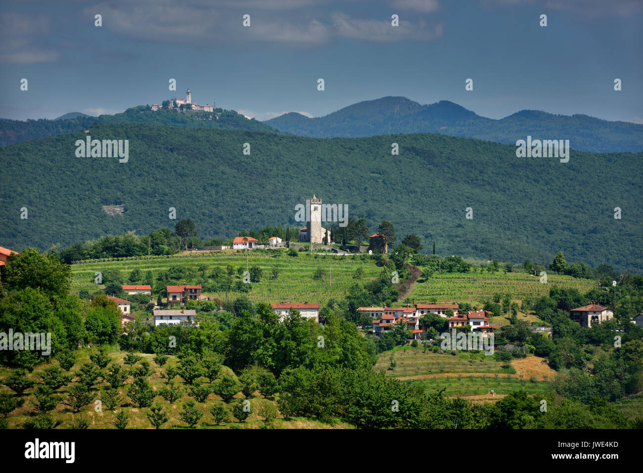 View of Church of the Holy Cross in Kojsko and Sveta Goro Holy Mountain with Basilica of the Assumption of Mary from Smartno Brda Slovenia - Stock Image
