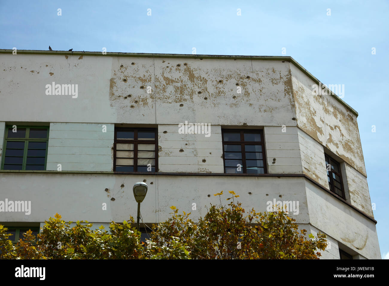 Building with bullet holes in Plaza Murillo (scene of many coups and conflicts), central La Paz, Bolivia, South America - Stock Image