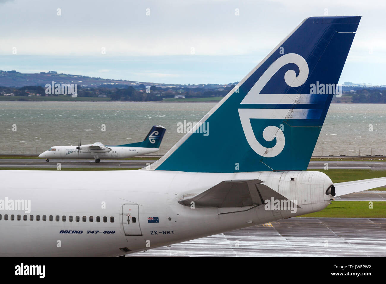 Air New Zealand Boeing 747-419 ZK-NBT on the tarmac at Auckland International Airport with an Air New Zealand Dash 8 behind. - Stock Image