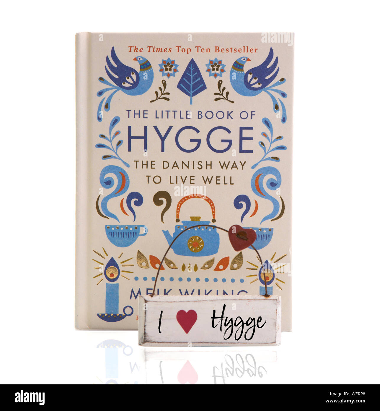 SWINDON, UK - AUGUST 1, 2017: The Little book Of Hygge, The Danish way to live well on a White Background - Stock Image