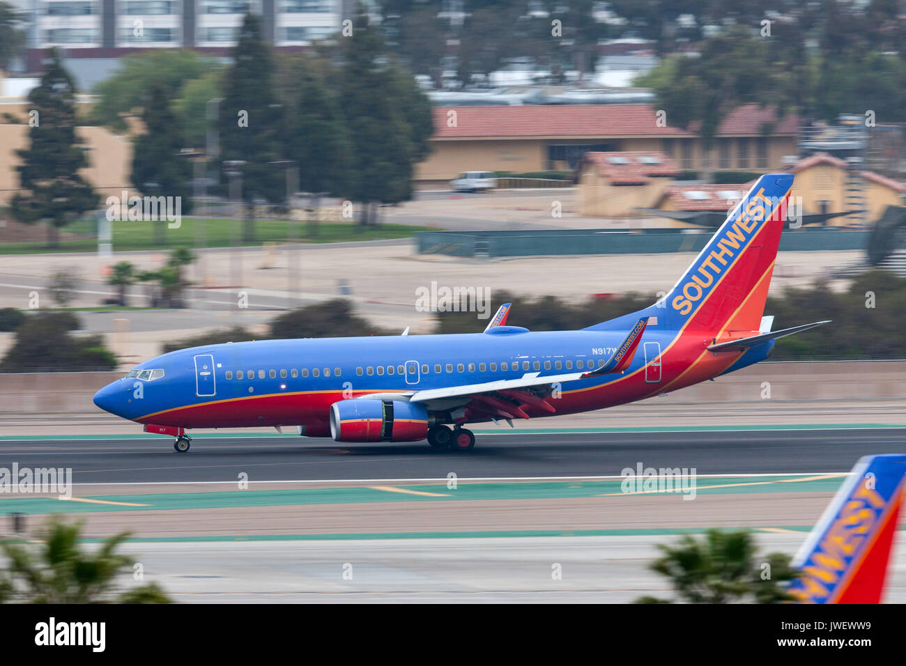 Southwest Airlines Boeing 737-7H4 N917WN arriving at San Diego International Airport. - Stock Image