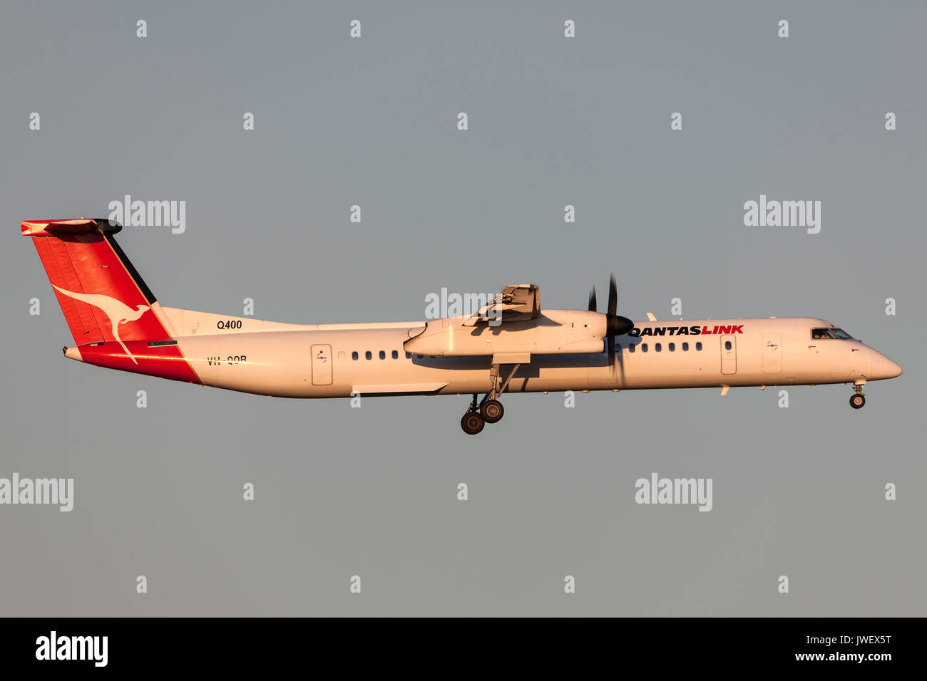 QantasLink de Havilland Canada DHC-8-402Q (Dash 8 Q400) VH-QOR on approach to land at Melbourne International Airport. - Stock Image