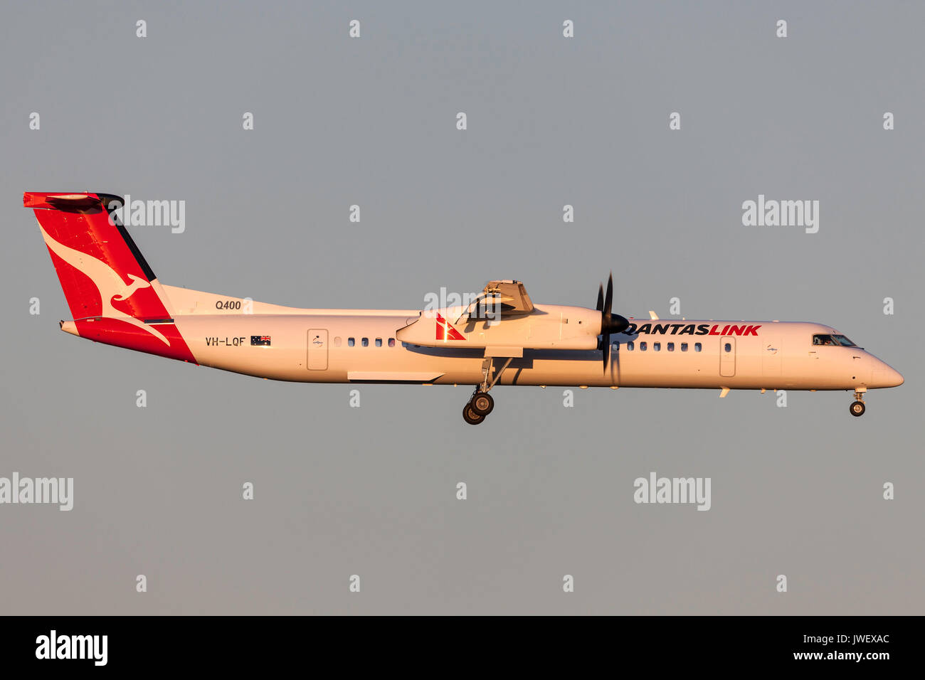 QantasLink de Havilland Canada DHC-8-402Q (Dash 8 Q400) VH-LQF on approach to land at Melbourne International Airport. - Stock Image