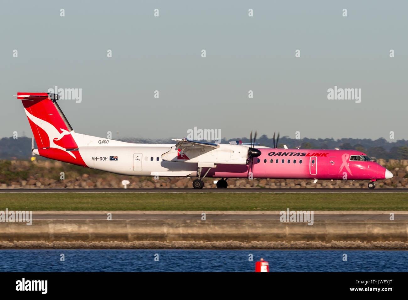 QantasLink (Qantas) deHavilland DHC-8 (Dash 8) twin engined regional airliner aircraft at Sydney Airport. Stock Photo