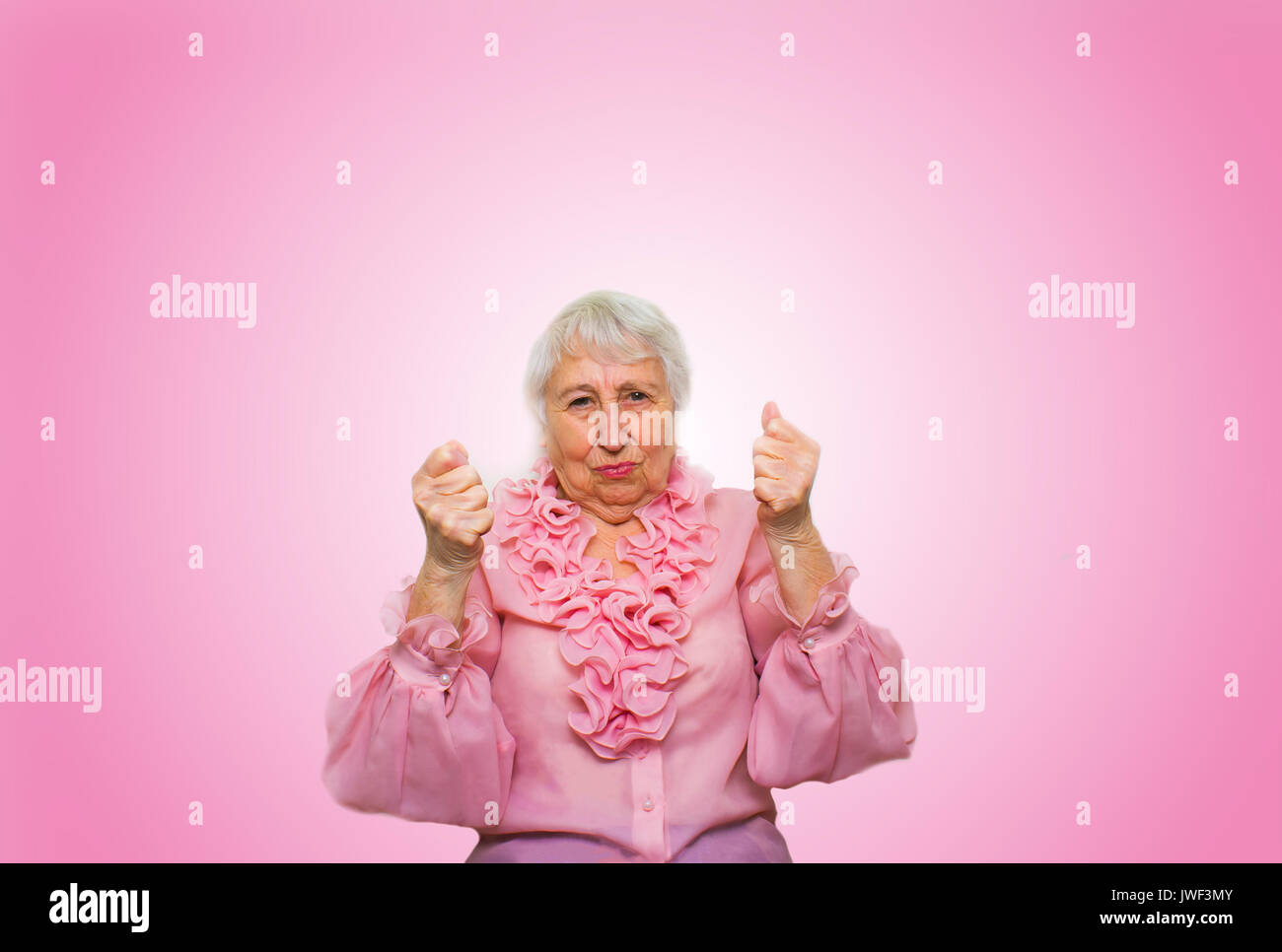 Elderly woman in suspense and determination - Stock Image
