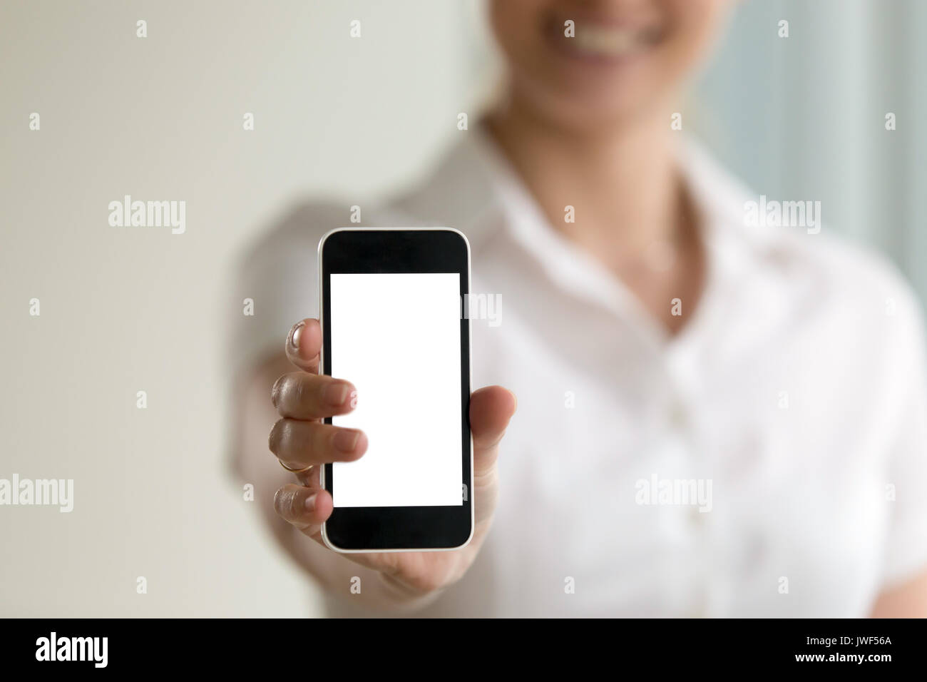 Woman holding smartphone, mockup screen for mobile ads, copy spa - Stock Image