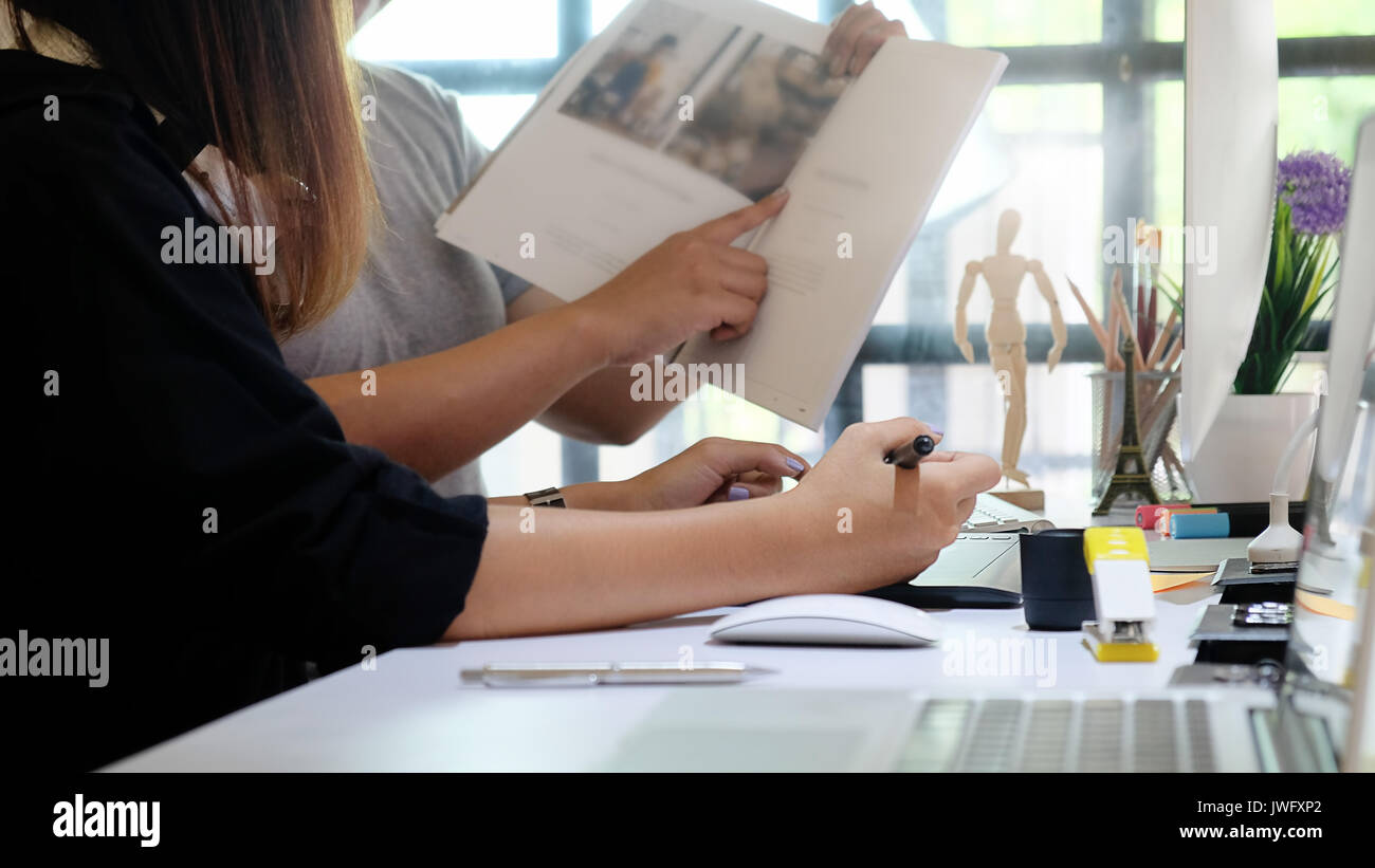 Editor talking a plan for magazine edit team of creative in Publisher office. - Stock Image