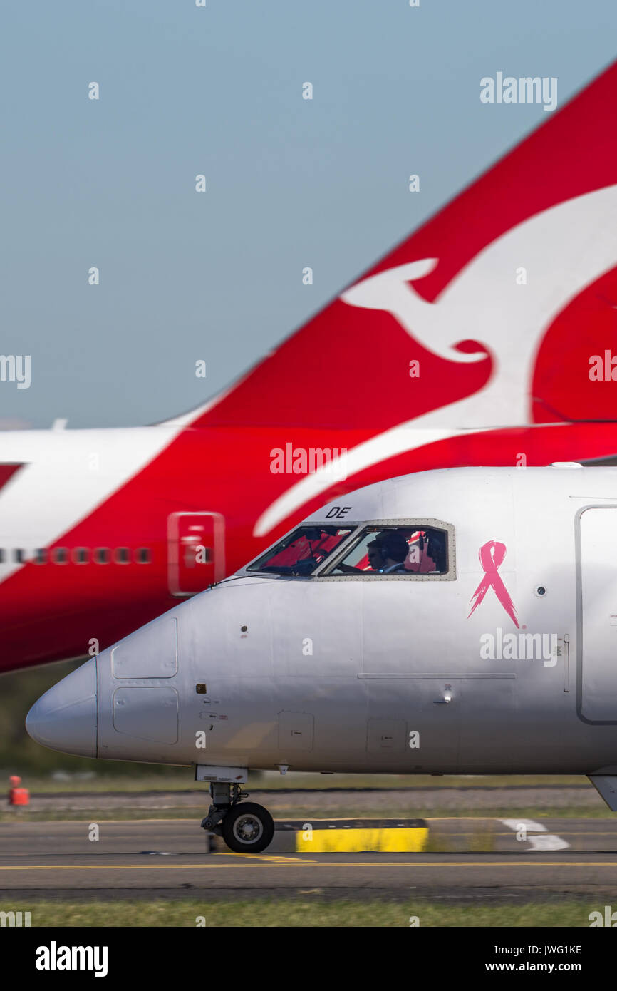 QantasLink Dehavilland DHC-8 (Dash 8) twin engined regional airliner at Sydney Airport. Stock Photo