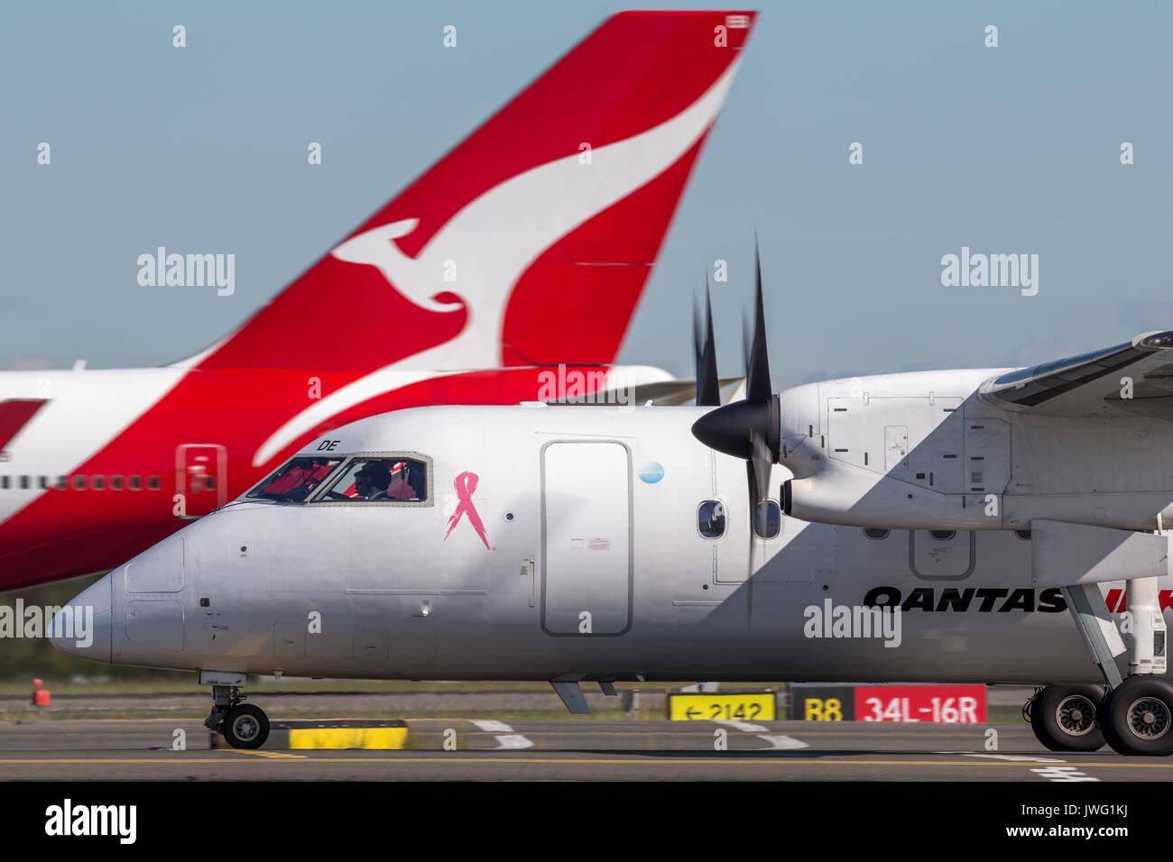 QantasLink Dehavilland DHC-8 (Dash 8) twin engined regional airliner at Sydney Airport. - Stock Image