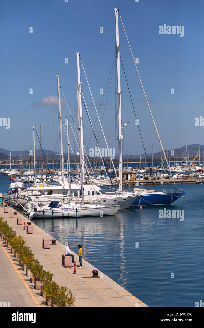 Luxury yachts in the port of Alghero in the province of Sassari on the northwest coast of the island of Sardinia, Italy. - Stock Image