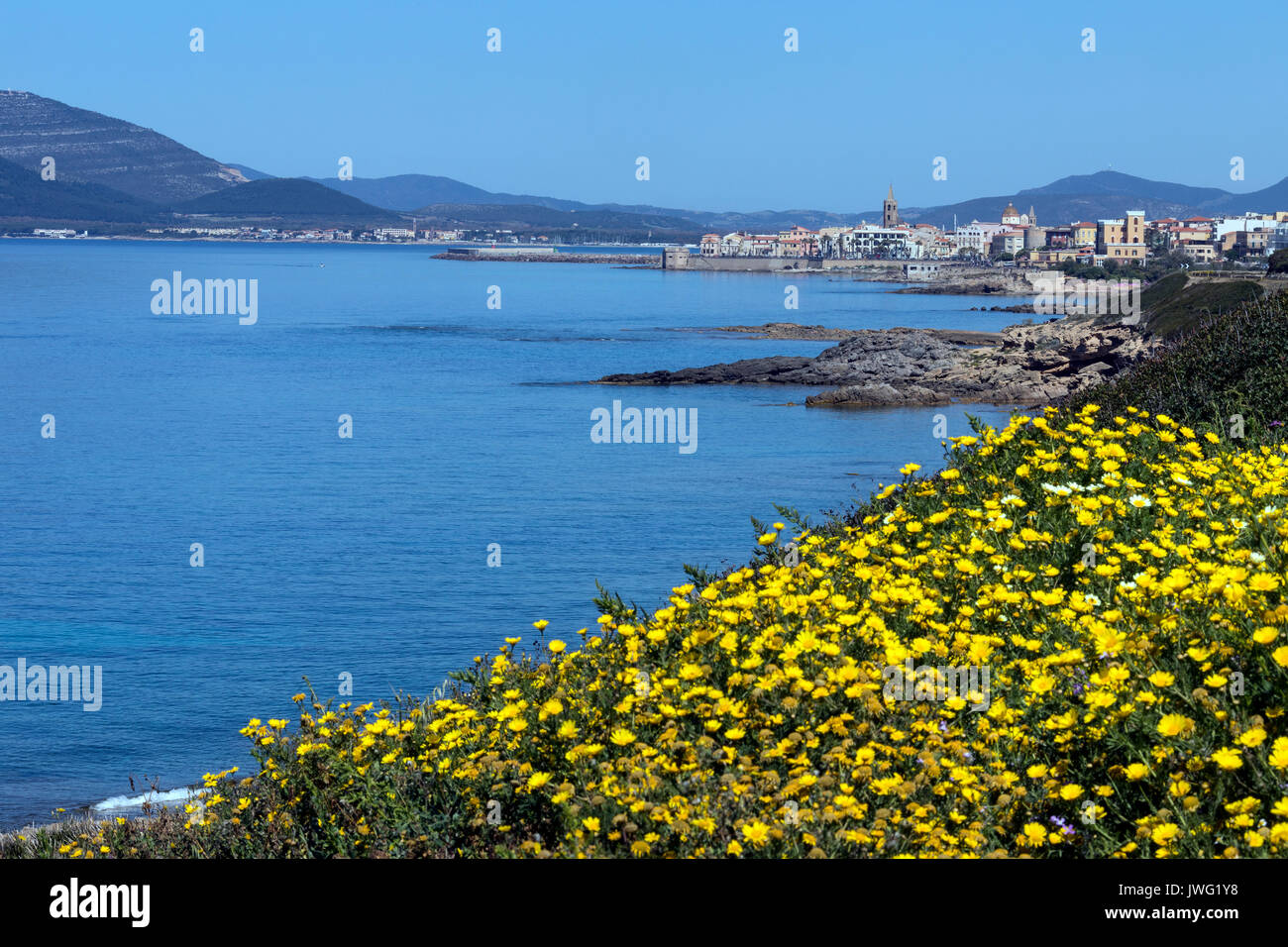 The coastline near the port of Alghero in the province of Sassari on the northwest coast of the island of Sardinia, Italy. - Stock Image