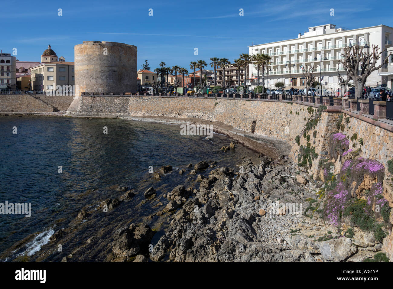 Porta a Terra Tower in the town of Alghero in the province of Sassari on the northwest coast of the island of Sardinia, Italy. - Stock Image