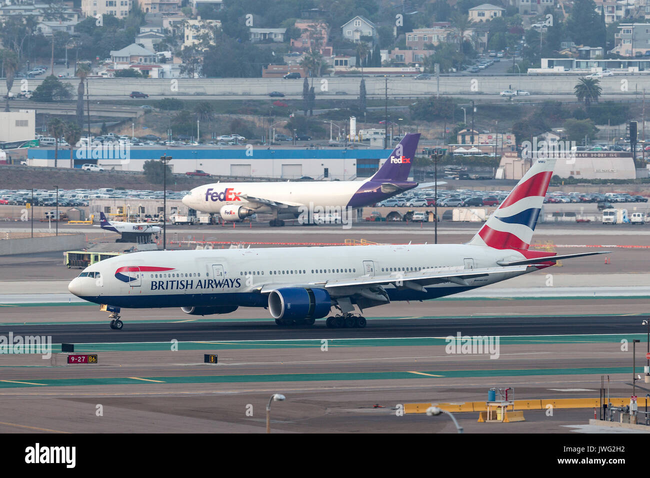 British Airways Boeing 777-236/ER G-YMMU arriving at San Diego International Airport. - Stock Image