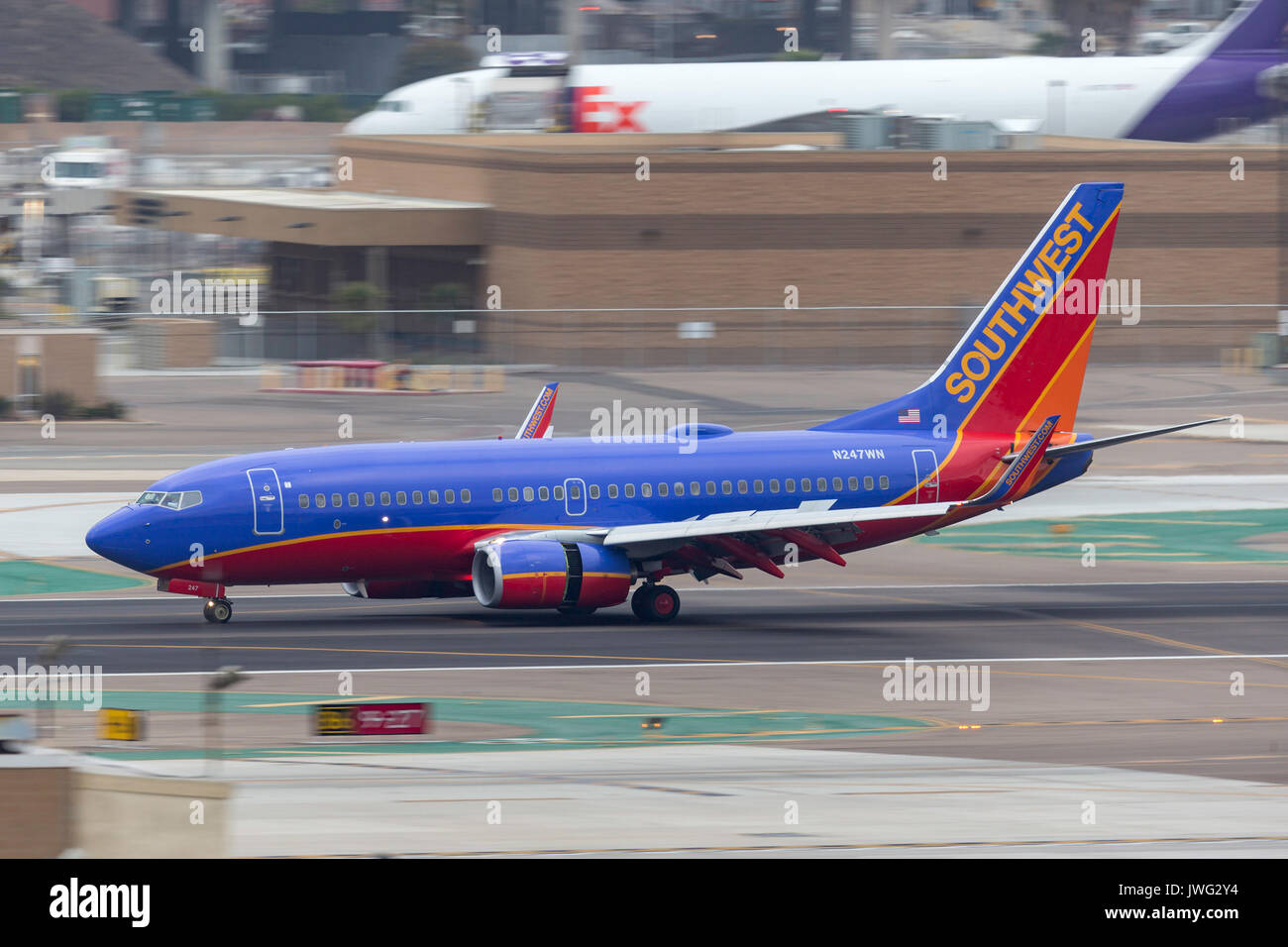Southwest Airlines Boeing 737-7H4 N247WN arriving at San Diego International Airport. - Stock Image