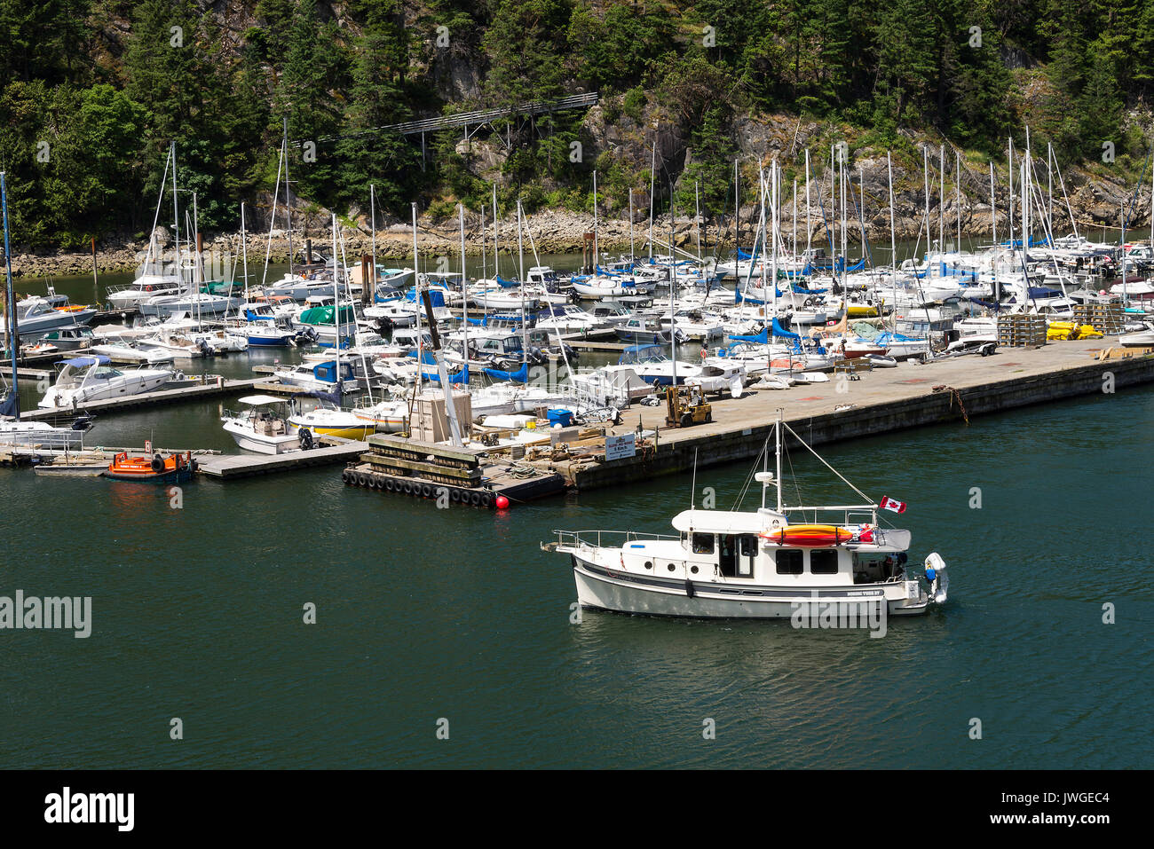 A Marina With Private Yachts ,Cabin Cruisers and Luxury Boats at Horseshoe Bay near BC Ferries Ferry Terminal in British Columbia Canada - Stock Image