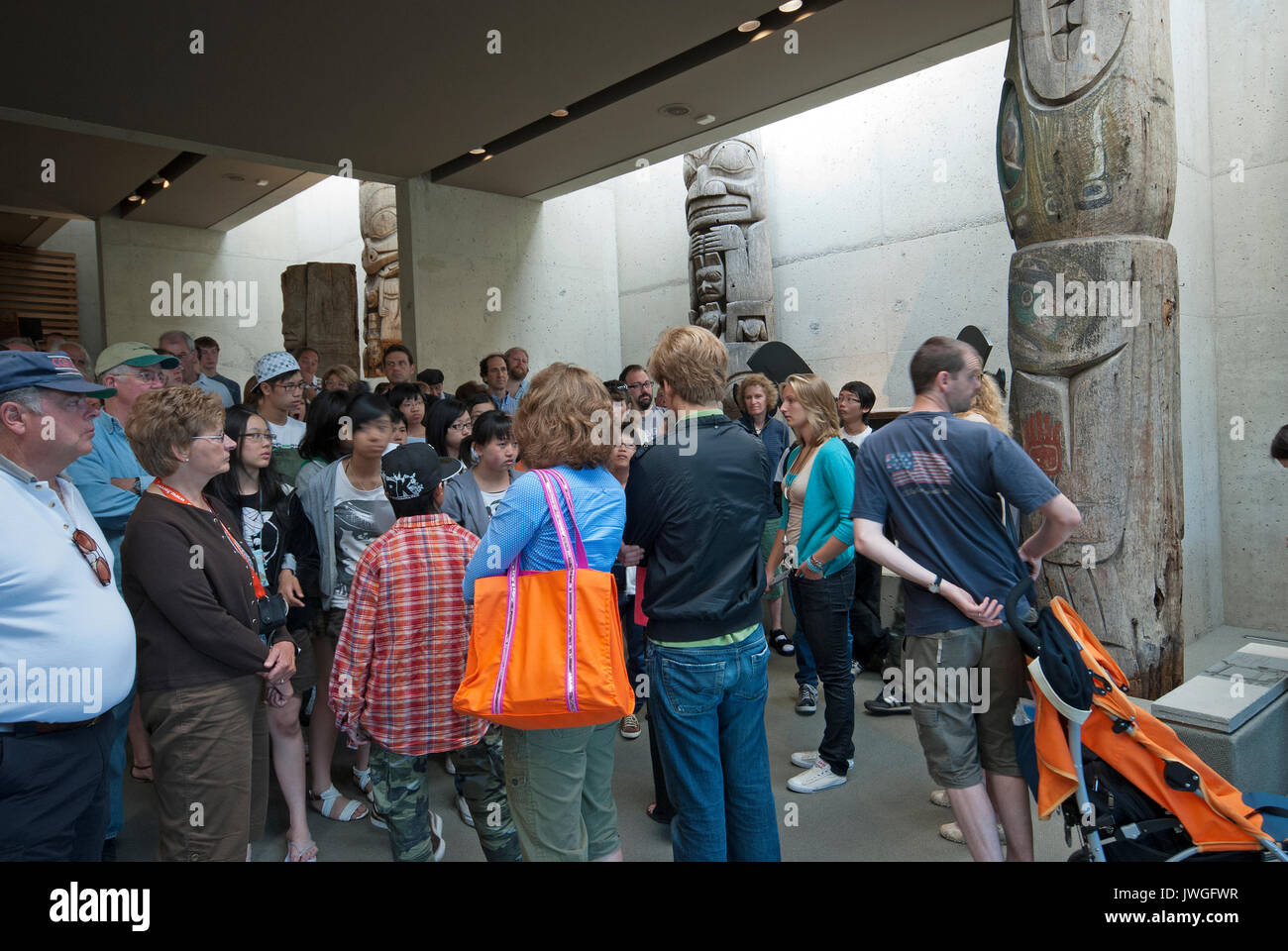 Haida totem poles and visitors at Museum of Anthropology, Vancouver, British Columbia, Canada - Stock Image