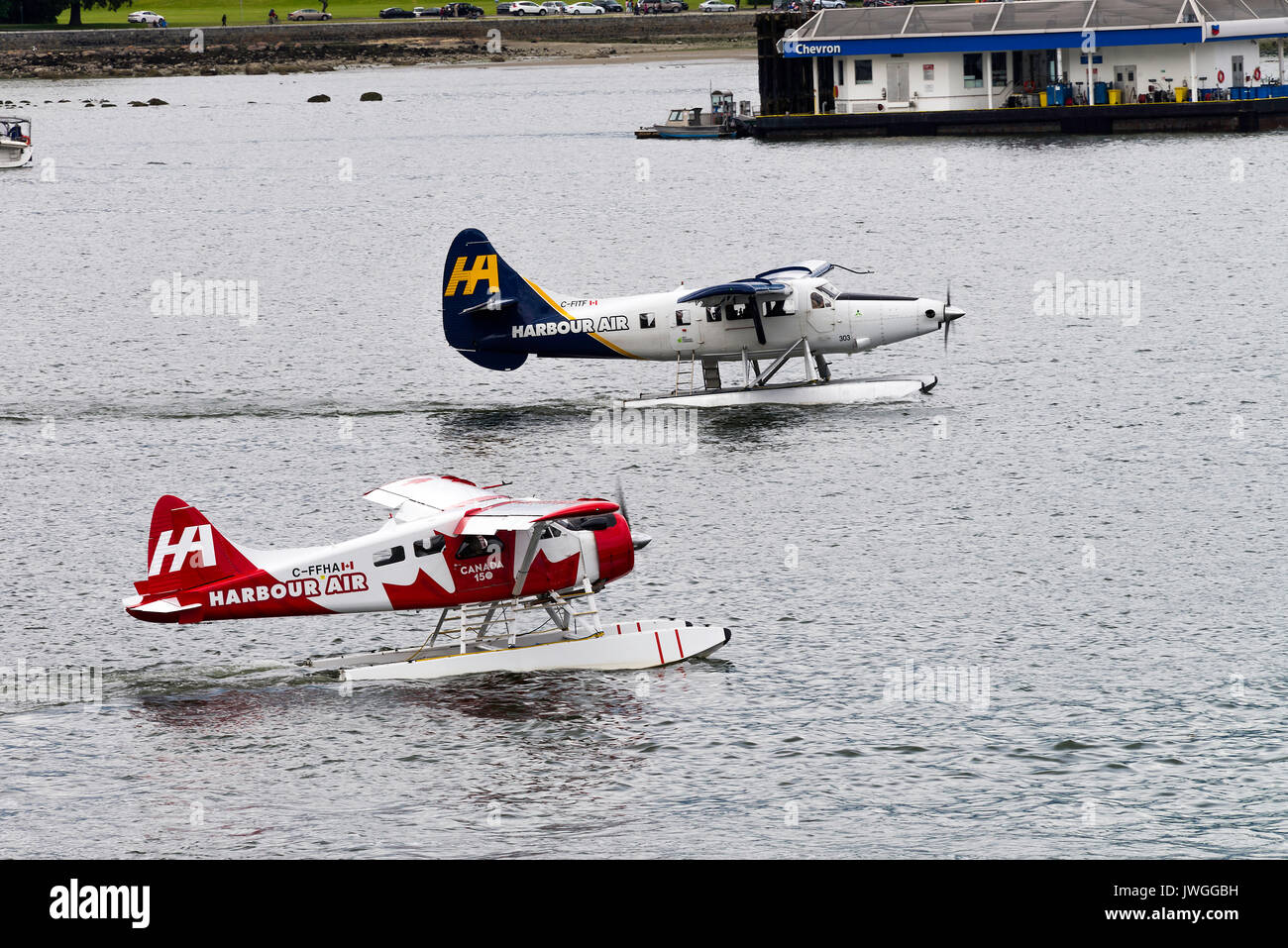 Harbour Air Passenger Seaplanes Taxiing on Water at Vancouver British Columbia Canada - Stock Image