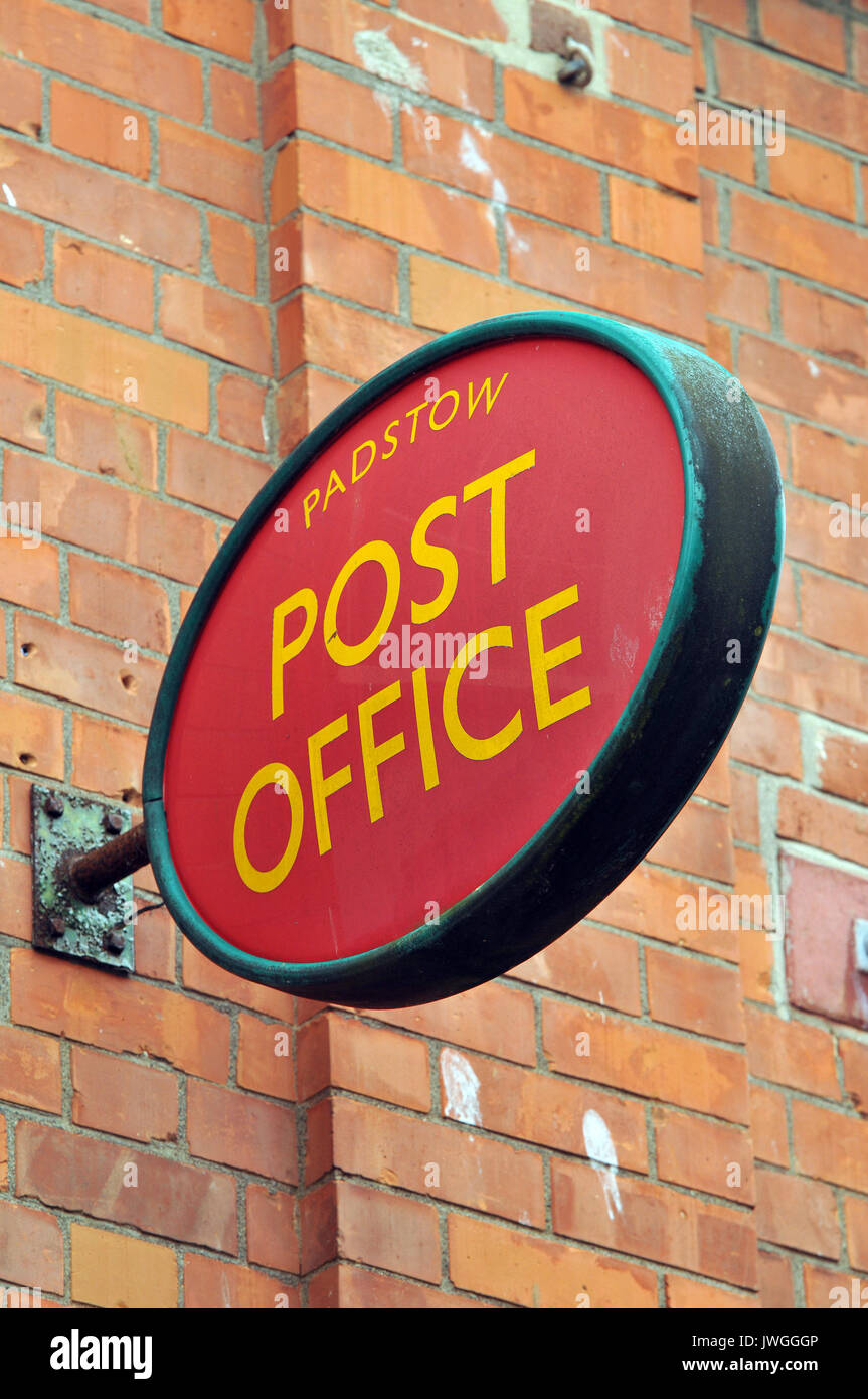 Post office signs and postal posting boxes at padstow post office in north cornwall. Collection times and red letter boxes with illuminated oval sign. - Stock Image
