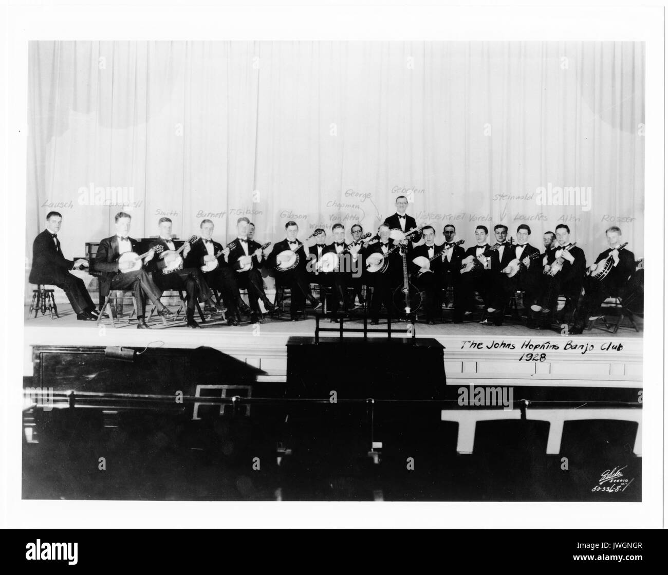 Banjo Club Banjo Club, all members identified, sitting on stage with instruments, 1928. - Stock Image