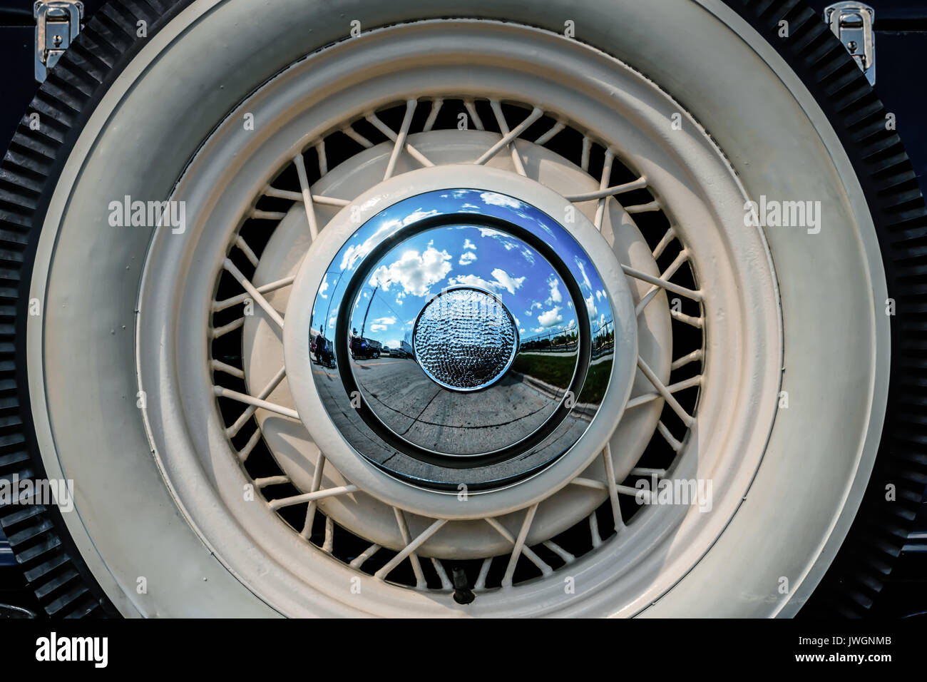 The spare tire on the back of a 1934 classic American car found in Wisconsin. - Stock Image
