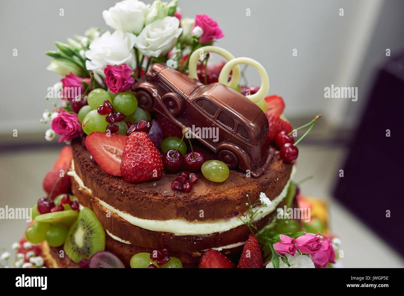 Wedding cake with a chocolate car Stock Photo