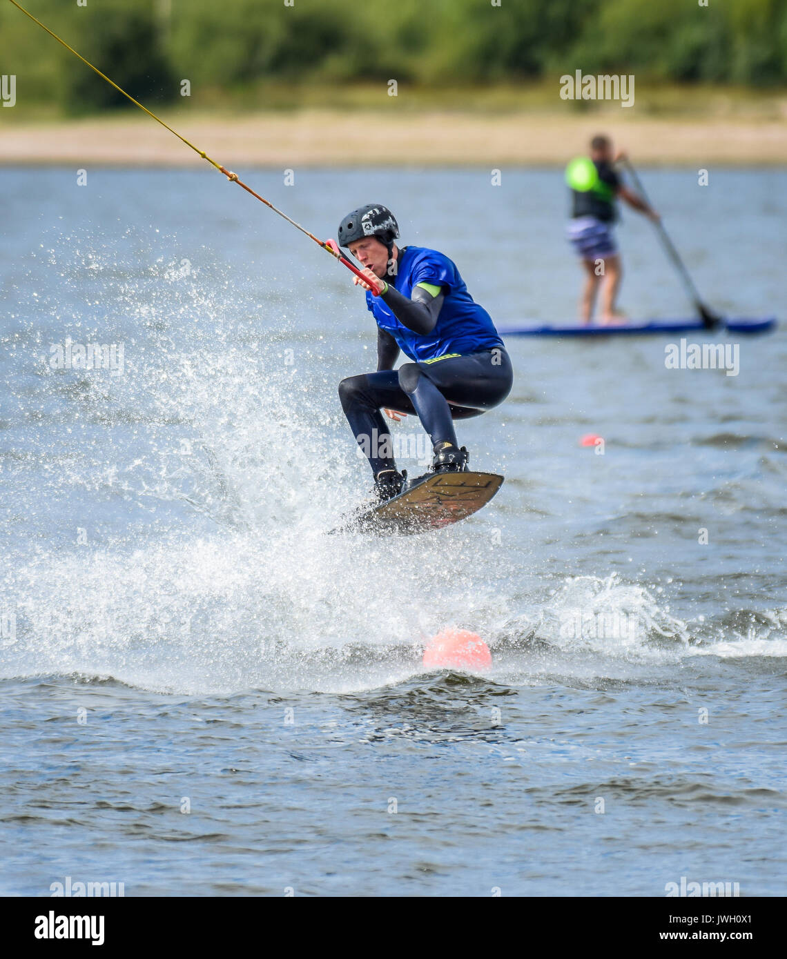 Wakeboarding via a cable tow system at Chasewater, Staffordshire, UK - Stock Image