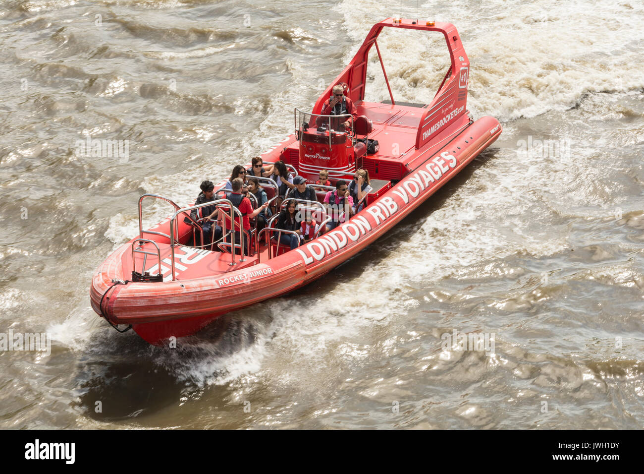 Tourists enjoying a high speed trip down the River Thames on a London Rib Voyages inflatable. London, UK. - Stock Image