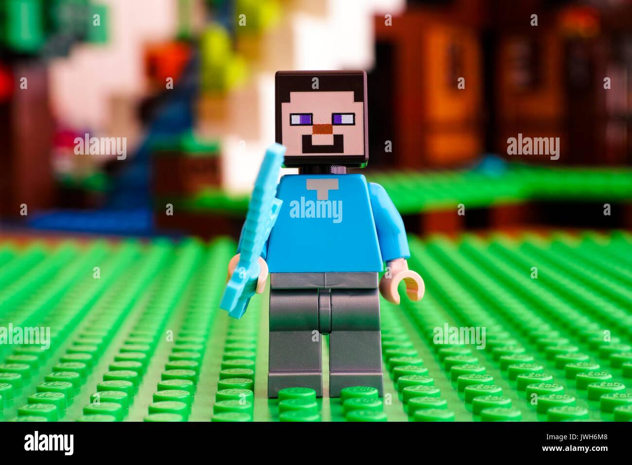 Tambov, Russian Federation - June 25, 2017 LEGO Minecraft. Steve minifigure with diamond sword. Green baseplate. Studio shot. - Stock Image