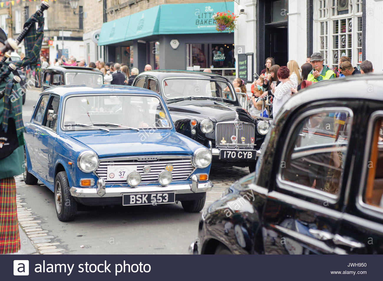 South Queensferry, UK. 12th Aug, 2017. South Queensferry, UK. August 12th, 2017. Some of the vintage vehicles as the procession winds it's way along the High Street. QueensferryÕs annual Fair is a week-long event and is principally a festival of sports and entertainments for the towns schoolchildren, culminating in a procession through the town and the crowning of the Fair Queen. Credit: Roger Gaisford/Alamy Live News - Stock Image