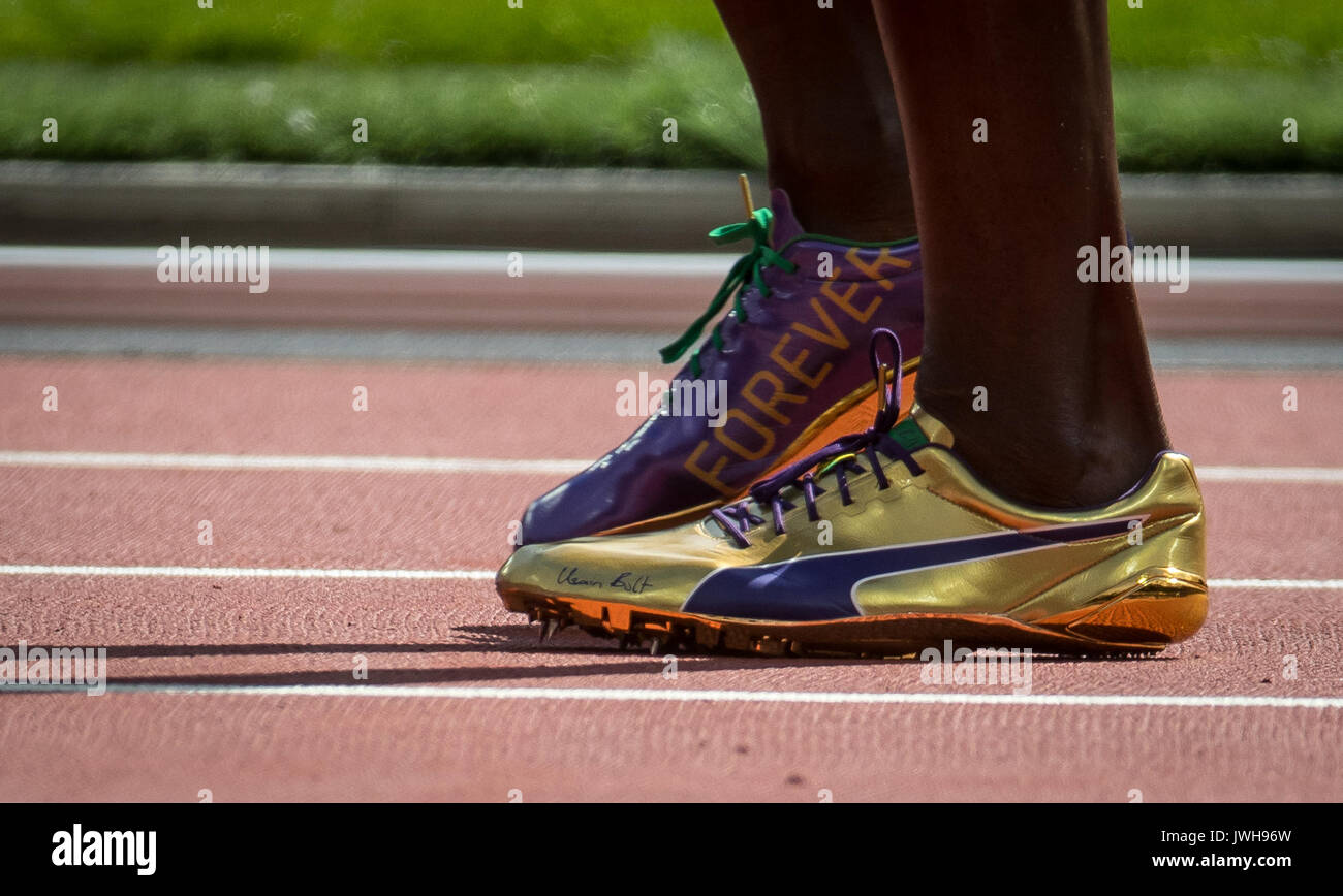992667cc330f5a Usain BOLT of Jamaica personalised Gold Puma running shoes displaying  FOREVER   his Name during the IAAF World Athletics Championships 2017 on DAY  9 at the ...