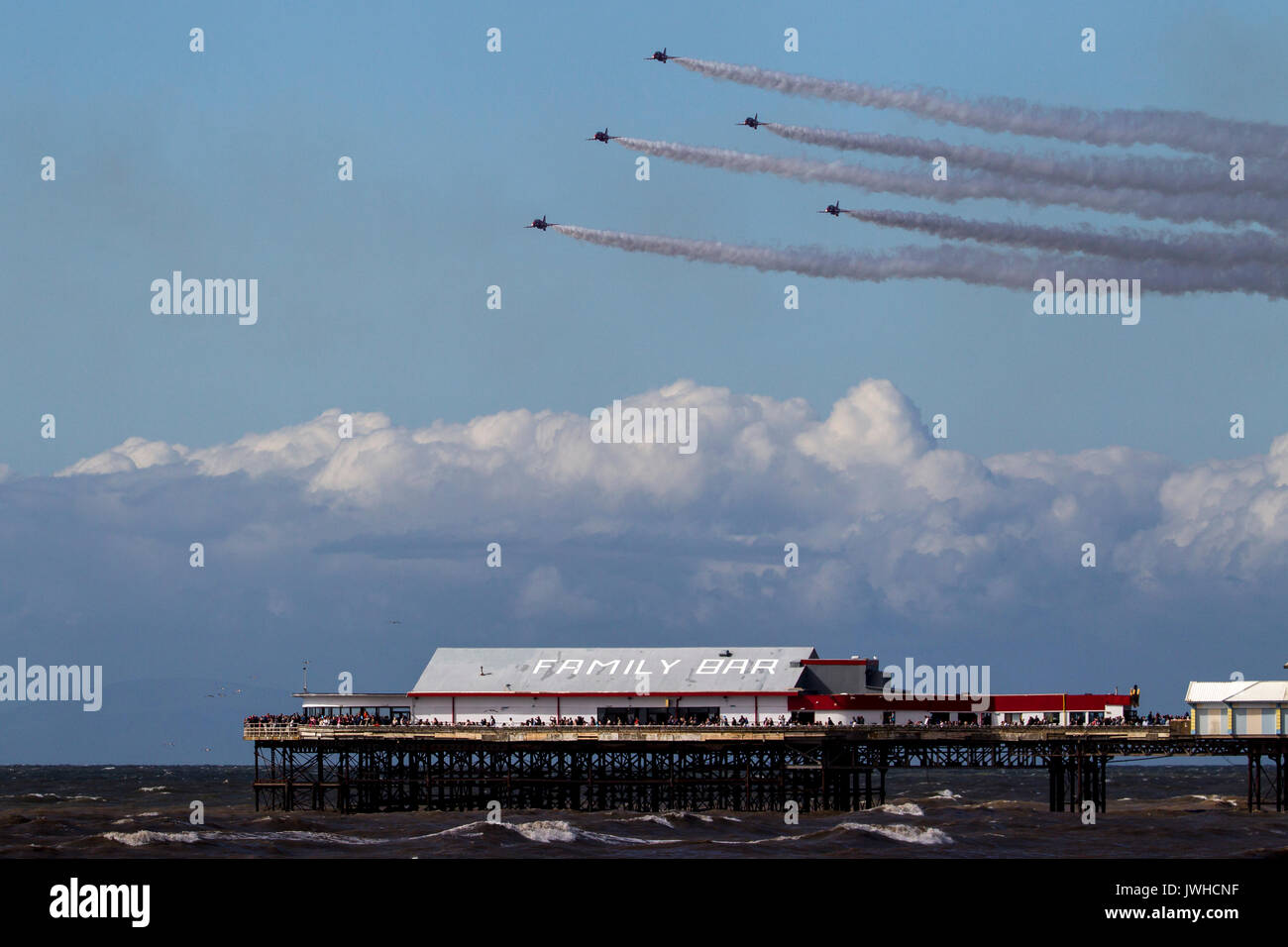 Blackpool, Lancashire, UK. 12th Aug, 2017. The RAF Red Arrows apparently overflying the Central Pier at Blackpool Credit: Russell Millner/Alamy Live News - Stock Image