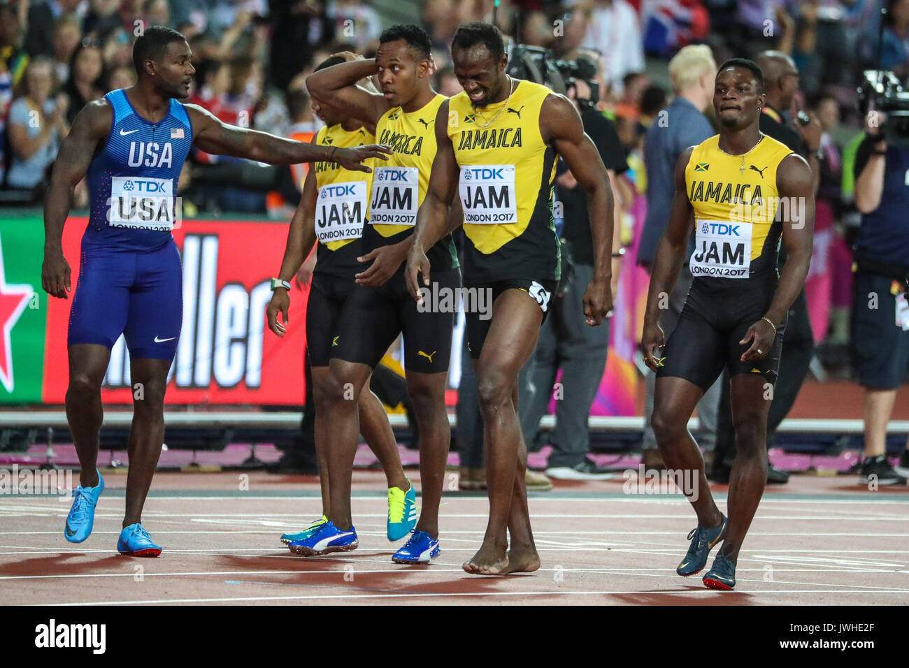 London, UK. 12th Aug, 2017. London, August 12 2017 . Justin Gatlin wishes Usain Bolt well after he pulled up injured as he ran the final 100m in the men's 4x 100m relay on day nine of the IAAF London 2017 world Championships at the London Stadium. Credit: Paul Davey/Alamy Live News - Stock Image