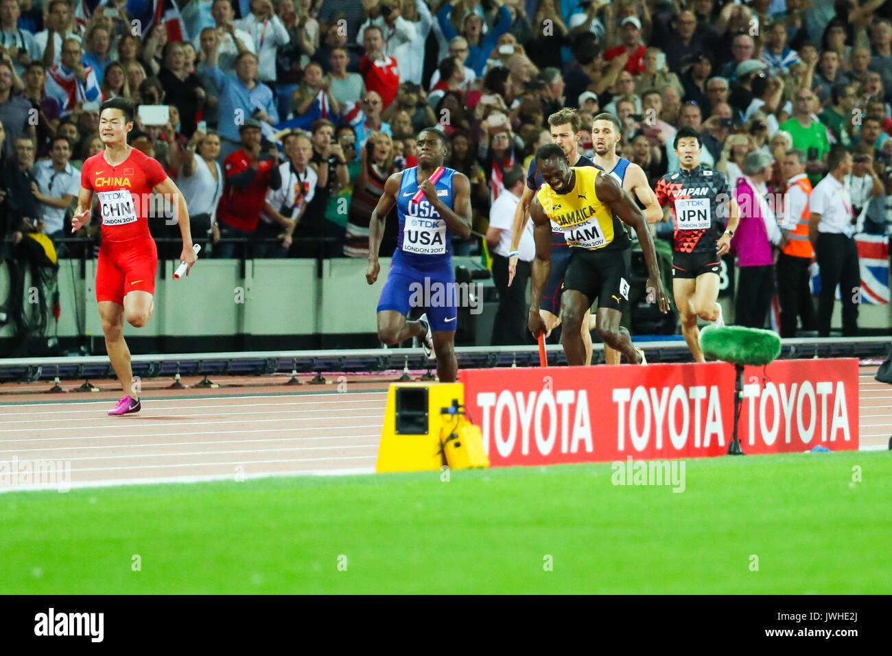 London, UK. 12th Aug, 2017. London, August 12 2017 . Usain Bolt, anchor for Jamaica, pulls up in the anchor leg with a hamstring injury in the men's 4x 100m relay on day nine of the IAAF London 2017 world Championships at the London Stadium. Credit: Paul Davey/Alamy Live News - Stock Image
