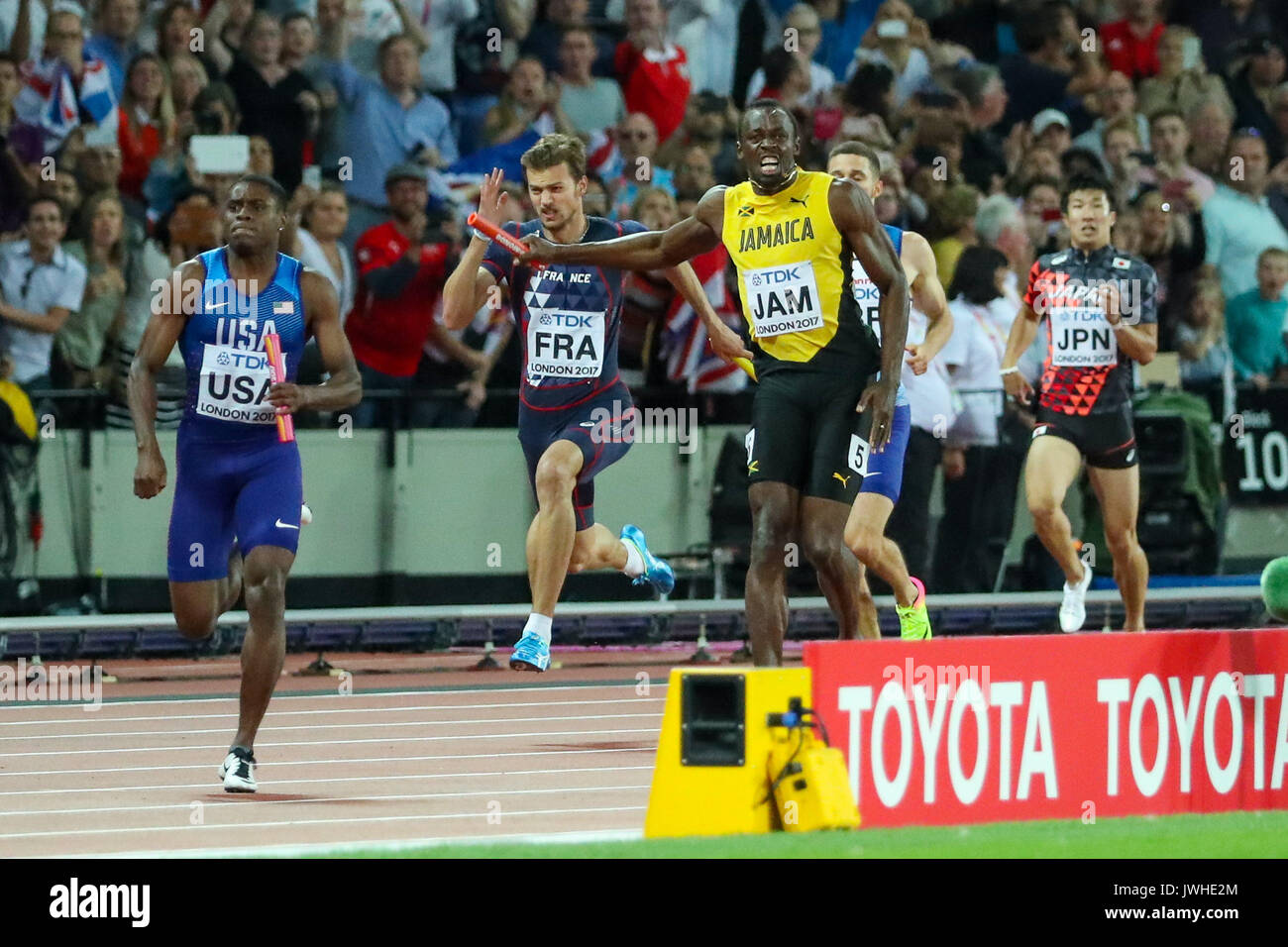 London, UK. 12th Aug, 2017. London, August 12 2017 . Usain Bolt, anchor for Jamaica, pulls up in in agony with a hamstring injury in the men's 4x 100m relay on day nine of the IAAF London 2017 world Championships at the London Stadium. Credit: Paul Davey/Alamy Live News - Stock Image
