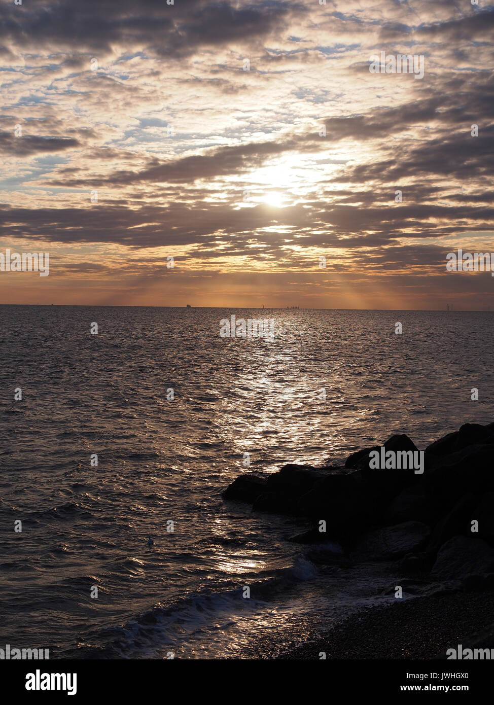 Sheerness, Kent. 13 Aug, 2017. UK Weather: a red sky in the morning ('Shepherd's warning') as the sun broke through cloud cover. Credit: James Bell/Alamy Live News - Stock Image
