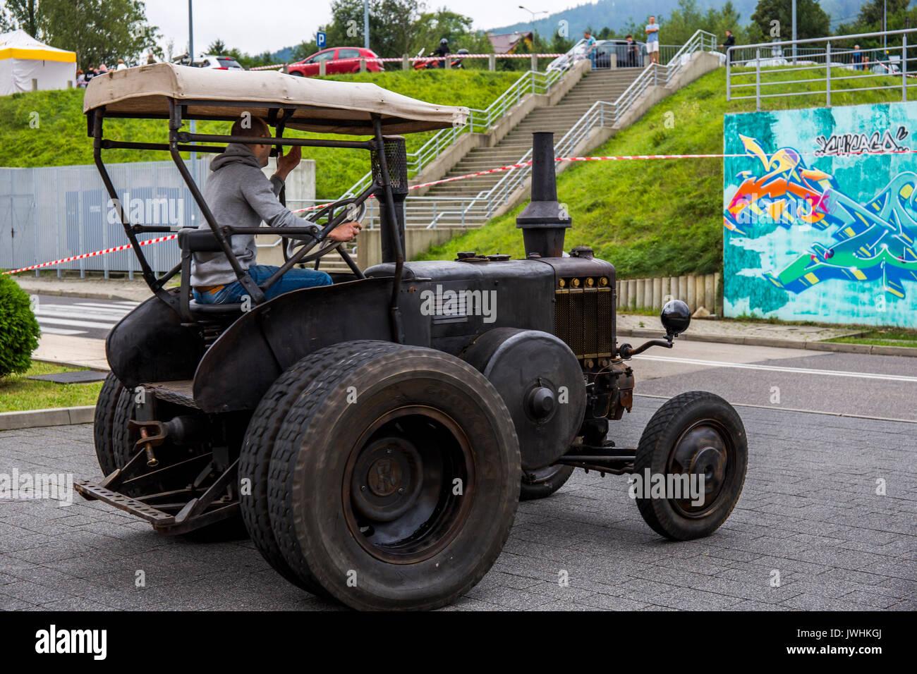 Bielsko-Biala, Poland. 12th Aug, 2017. International automotive trade fairs - MotoShow Bielsko-Biala. Man driving Stock Photo